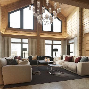 Интерьер гостиной со вторым светом в доме из клеёного бруса