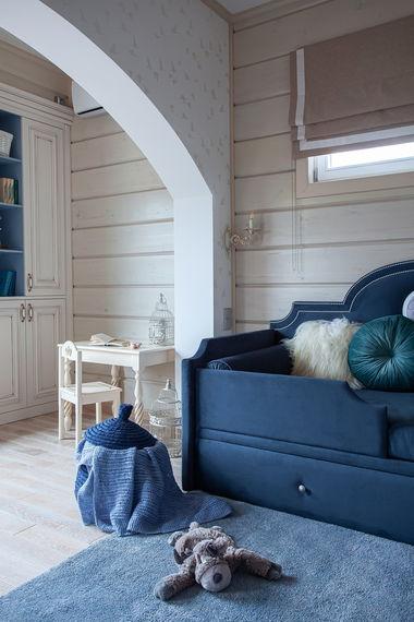 Интерьер детской в доме из клееного бруса.